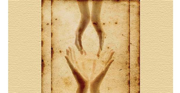 A picture of two pairs of hands exchanging energy