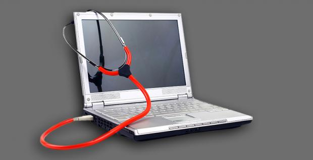 A picture of a laptop wrapped in a stethoscope