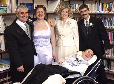 The author, above, third from left, is surrounded by her family (from left): husband Bob, daughter Jenn, son Bobby, with Joe in the foreground.