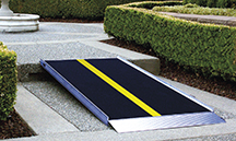 The EZ-Access Pathway Lite solid aluminum ramp features a skid-resistant surface, side curbs and a self-adjusting bottom transition plate.