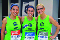 Emily Garcia (right) and Team Momentum members at the 2014 Chicago Marathon.