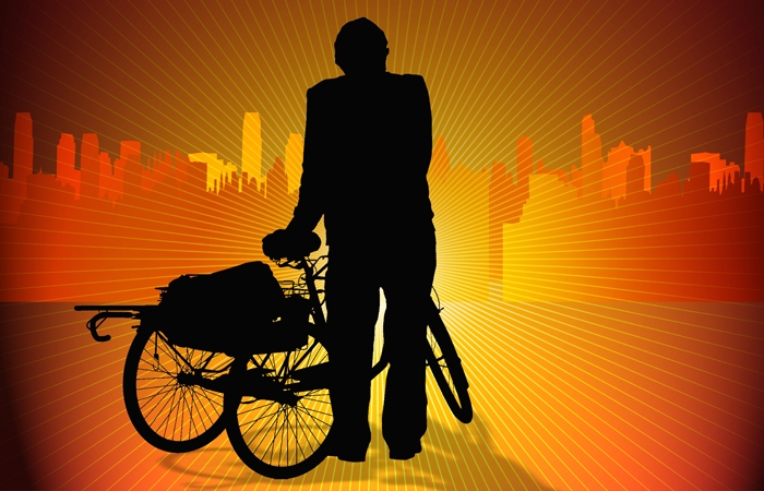 An orange graphic displaying a person with a tricycle