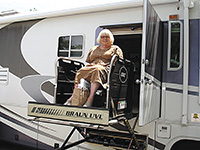 A Braun lift with its own door gives Barbara Graztke wheelchair access to her 40-foot motor home.
