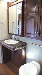An open-front bathroom sink, left, allows easy access for a wheelchair user.
