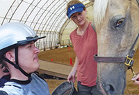 Trey Lovell and his horse, Comanche, prepare for their hippotherapy session.