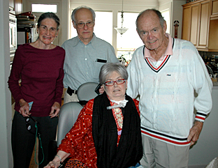 The author, center, in January, 2010, with her new trach; next to her is her father, and behind them is family friend Anne and Jan's husband, Milton.