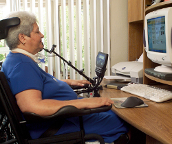 Woman working at a desktop computer