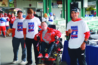 Teagan House and his high school football teammates raise funds for MDA Muscle Walk in 2015.