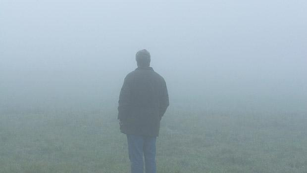 A man standing in the mist