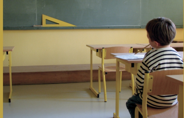 A picture of a young child in a classroom