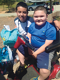 Christopher (right), a six-time camper, has made lifelong friends at camp.
