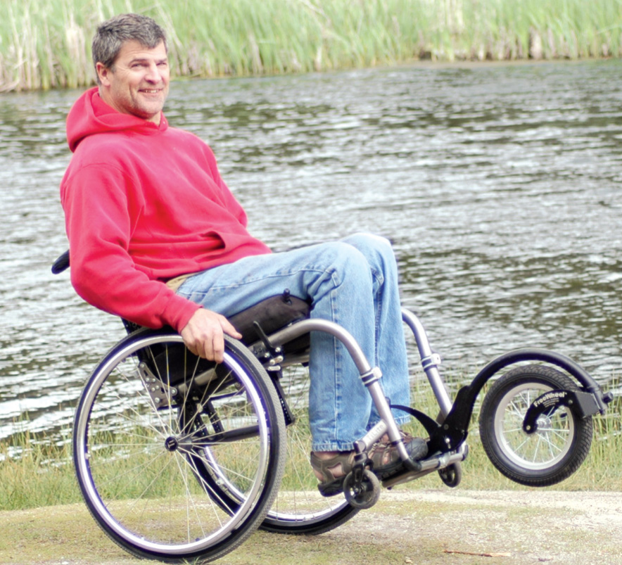 The FreeWheel is a single-wheel assembly that attaches to the front of a manual chair.