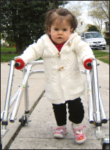 Kelly Trumpy, born with congenital myotonic dystrophy, is learning to walk using a posterior walker.