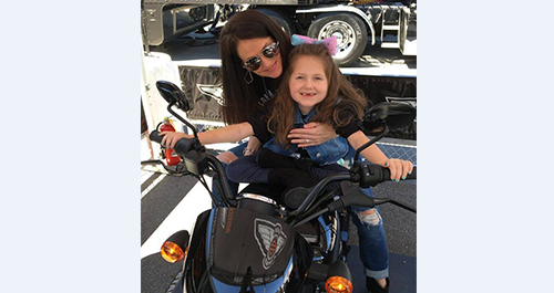 Faith Fortenberry and her mom on a Harley