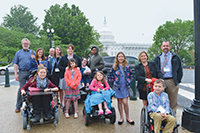 MDA Advocates from Missouri stopped for a photo in front of the U.S. Capitol between meetings with legislators to lobby for public policies important to the MDA community.