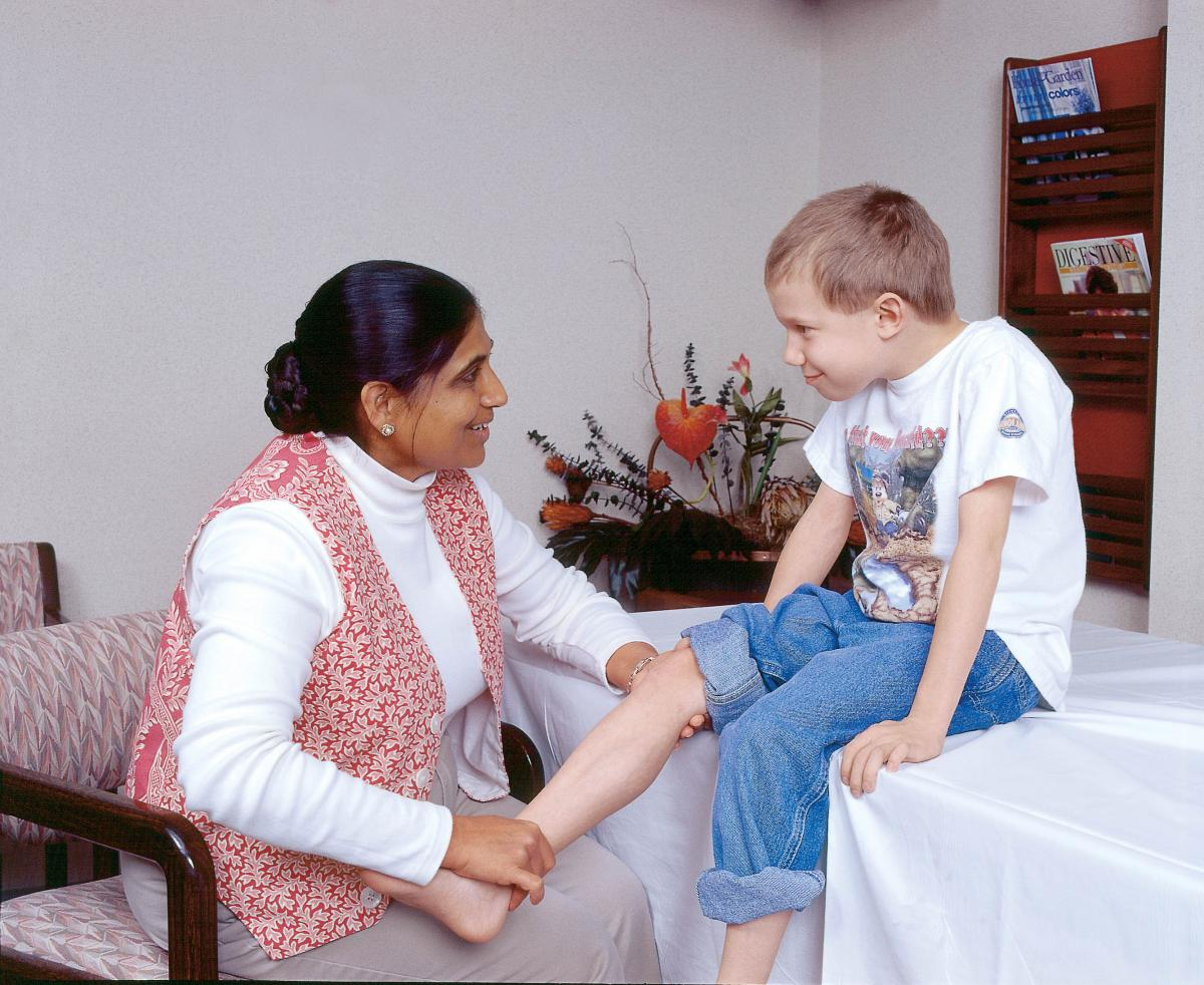 Boy with physical therapist