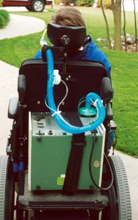 Mike N. in his power wheelchair with vent.