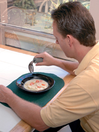 Man using an offset eating utensil
