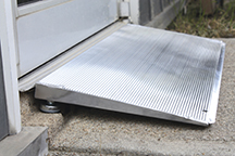 One of PVI's threshold ramps is self-supporting and has adjustable feet. The design covers a range of rises from 1 to 4 inches.