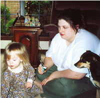 Jessica Aycock with her daughter, Jasmine, then 2, and dog, Angel. Although prednisone brought Aycock's dermatomyositis under control, it added 100 pounds to her small frame. She's now doing well on CellCept.