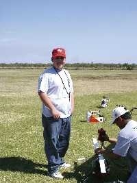 Jason Adamo (standing) at Fun Fly, a radio-controlled helicopter event in Florida.