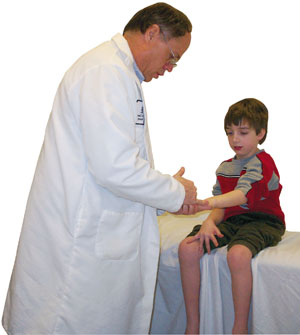 Neurologist Michael Shy examines Justin Wilton, 6, who may have CMT. A diagnostic workup for this disorder generally includes a careful family history, a physical exam, measurements of the speed and intensity of nerve impulses traveling between the spinal cord and muscles, and DNA testing.