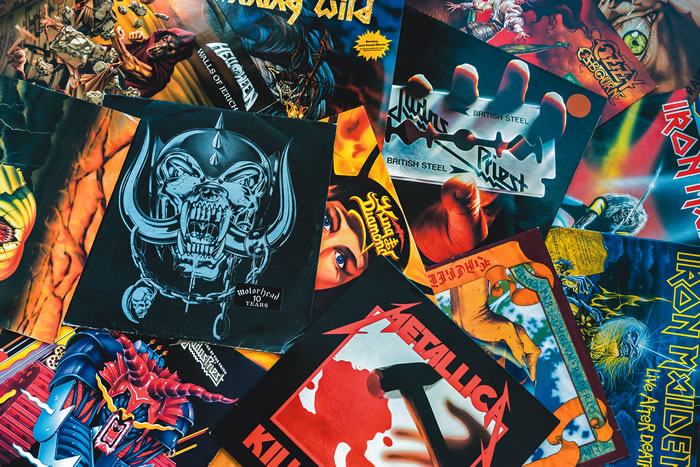 A collage of many different artworks from famous heavy metal bands, including Metallica, Iron Maiden, Judas Priest, and more