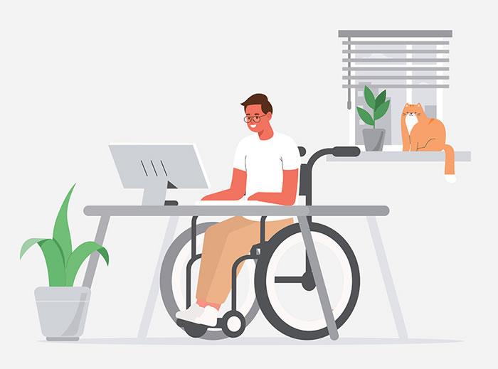 Man in wheelchair behind desk