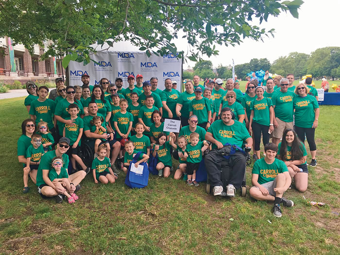 Christopher Carroll, fifth from left in the second row, was team captain of the Carroll Crusade at a recent MDA Muscle Walk event in the Philadelphia area.