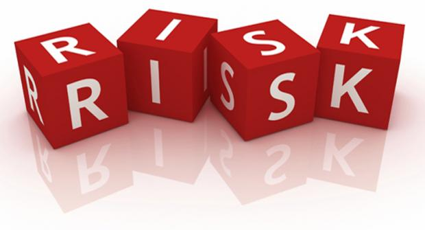 A graphic with red cubes with letters on them. They spell out the word 'risk'.